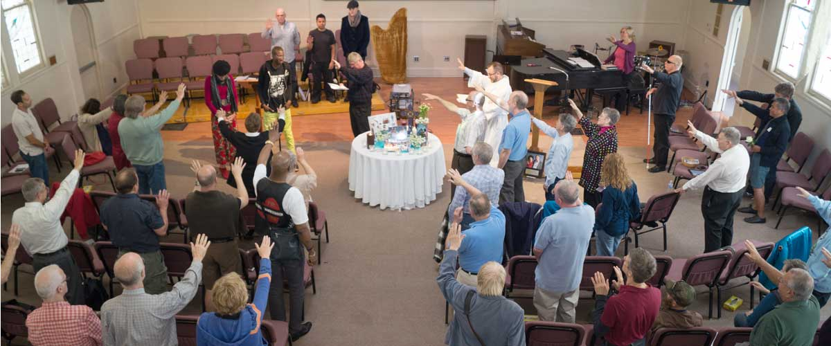 View from balconly of Sunday service with congregation's outstretched arms blessing our new members!