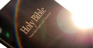 A375PX Holy Bible with lens flare and rainbow.